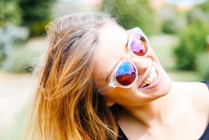 woman-smile-eyeglasses-sunglasses-hair-summer