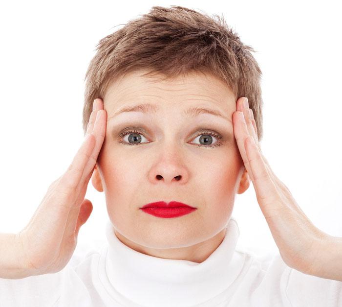 stress-ache-pain-headache-woman-scared-angry